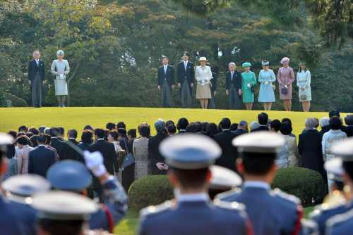 Japan's imperial family members listen to the national anthem during the annual autumn garden party at the Akasaka Palace imperial garden in Tokyo