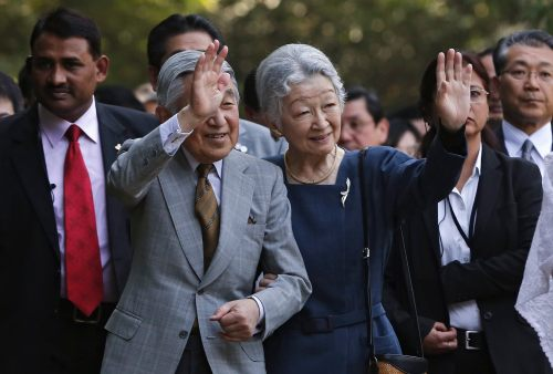 Japan's Emperor Akihito and Empress Michiko wave towards the crowd during their visit to the Lodhi garden in New Delhi