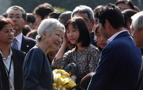 Japan's Empress Michiko interacts with guests during her visit to the Lodhi garden in New Delhi