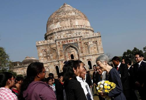 Japan's Emperor Akihito and Empress Michiko interact with guests during their visit to the Lodhi garden in New Delhi