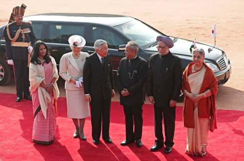 Japan's Emperor Akihito and Empress Michiko pose during emperor's ceremonial reception at the forecourt of India's presidential palace Rashtrapati Bhavan in New Delhi