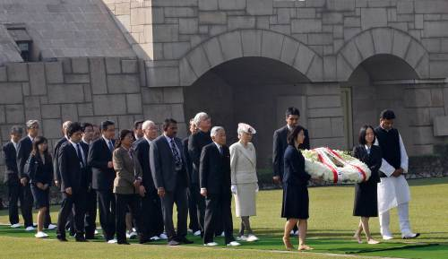 Japan's Emperor Akihito and Empress Michiko arrive to place a wreath at the Mahatma Gandhi memorial at Rajghat in New Delhi