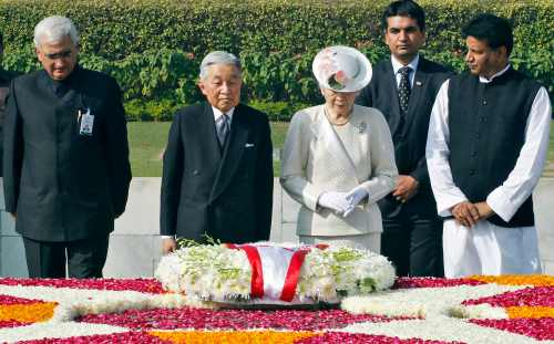 Japan's Emperor Akihito and Empress Michiko stand after placing a wreath at the Mahatma Gandhi memorial at Rajghat in New Delhi