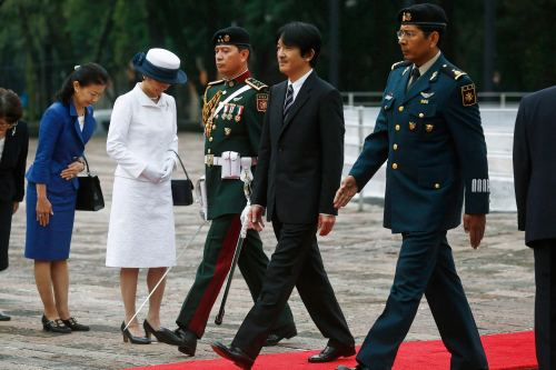 Akishino walks near his wife after offering a wreath at the Ninos Heroes monument in Mexico City